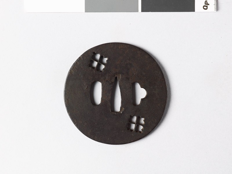 Lenticular tsuba with two karahana, or Chinese flowers (front           )