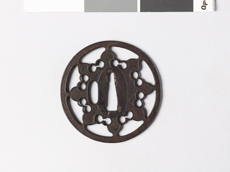 Tsuba with eight-petalled flower (front           )