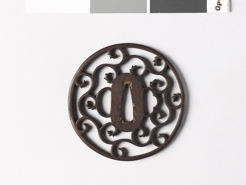 Round tsuba with karakusa, or scroll plant pattern