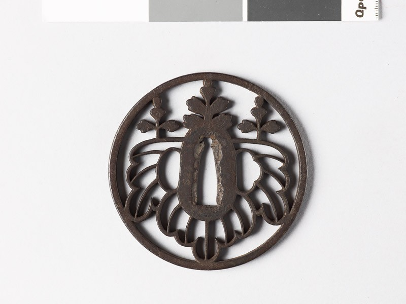 Round tsuba with gosan-no-kiri, or paulownia leaves