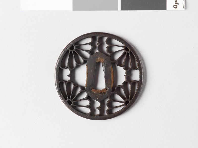 Round tsuba with karigane, or flying geese, and chrysanthemums (EAX.10028, front           )