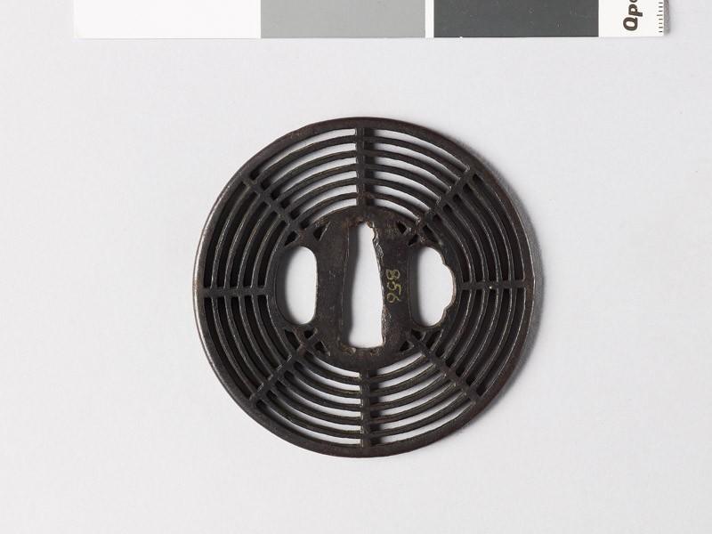 Round tsuba with cobweb design