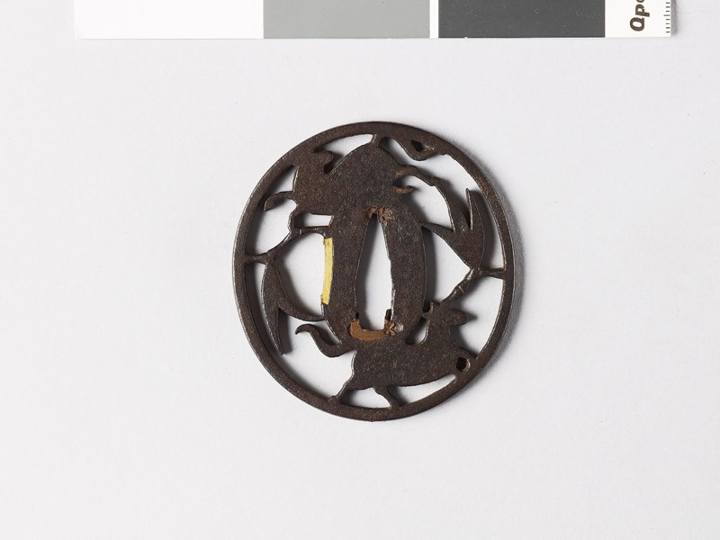 Tsuba with two horses and bamboo twigs