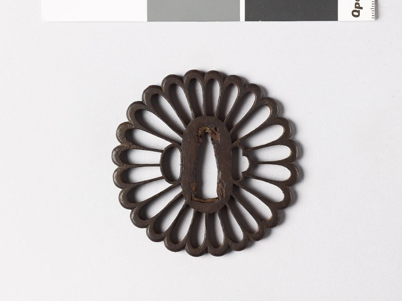 Tsuba in the form of a chrysanthemum (front           )
