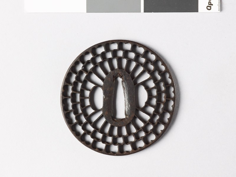 Round tsuba with radiating floral design (EAX.10041, front           )