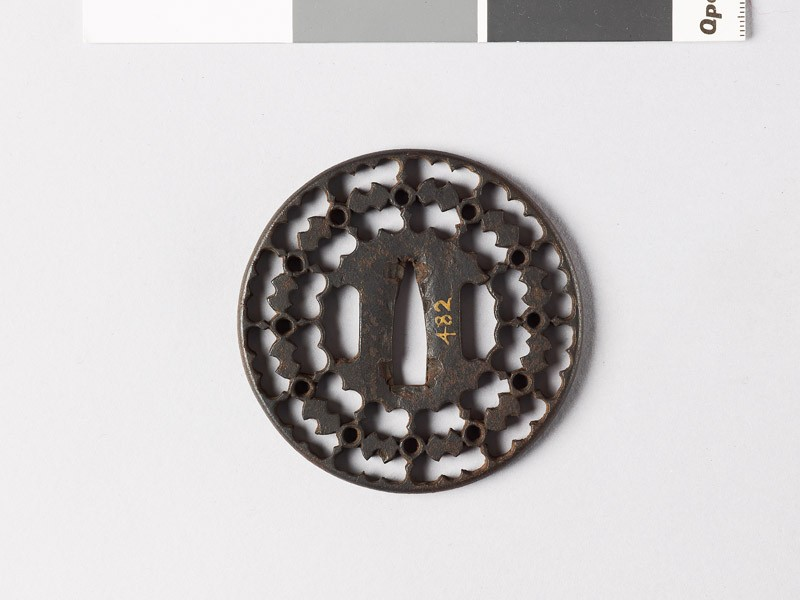 Round tsuba with fundō weights and circles