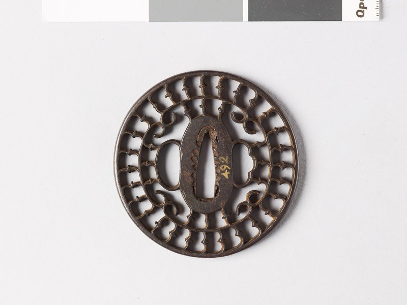 Tsuba with karigane, or flying geese, and c-scrolls (front           )