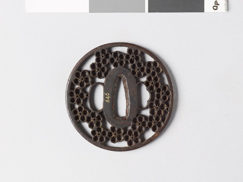 Round tsuba with plum and cherry blossoms (front           )