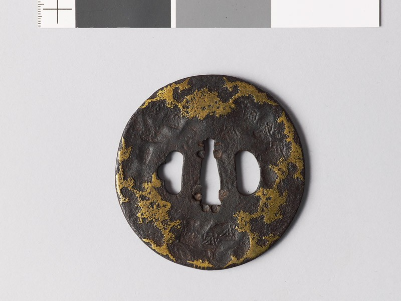 Tsuba with stylized snow decoration (front           )