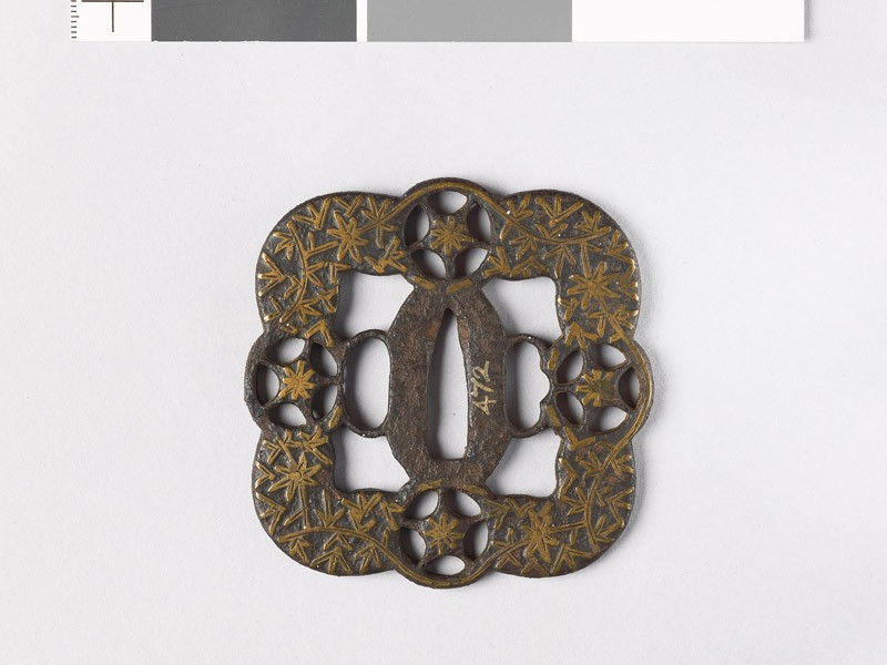 Tsuba with foliated stems and star shapes