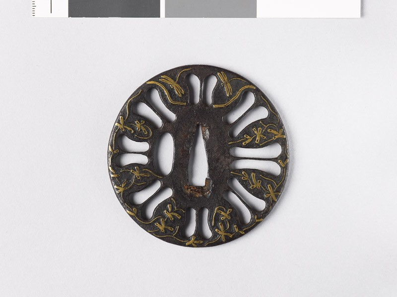 Tsuba with scrolls, dragonflies, and a stream (front           )