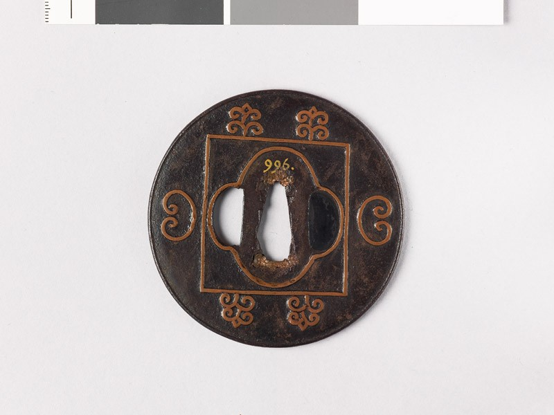 Lenticular tsuba with mokkō shape and C-scrolls