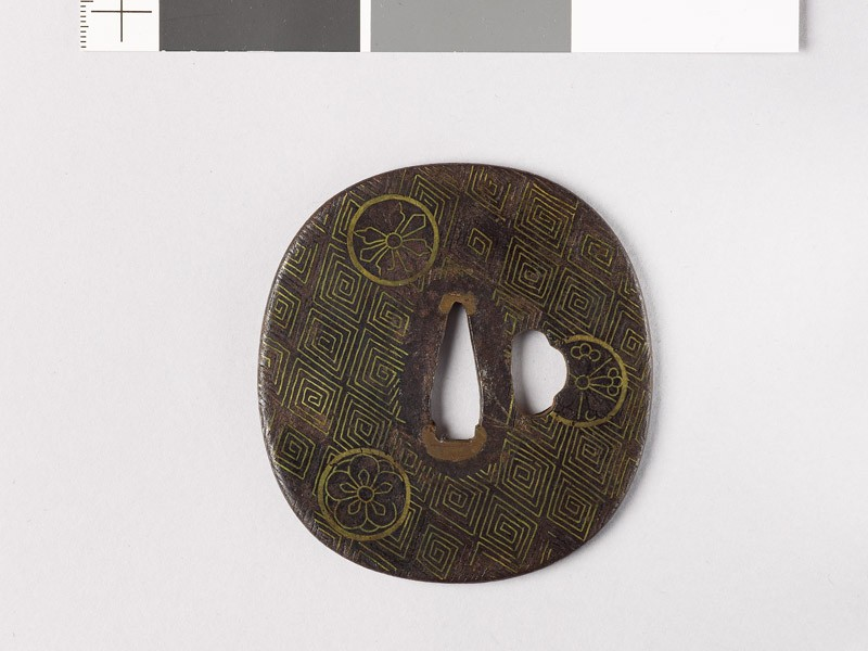 Tsuba with thunder-scroll pattern and flowers (front           )