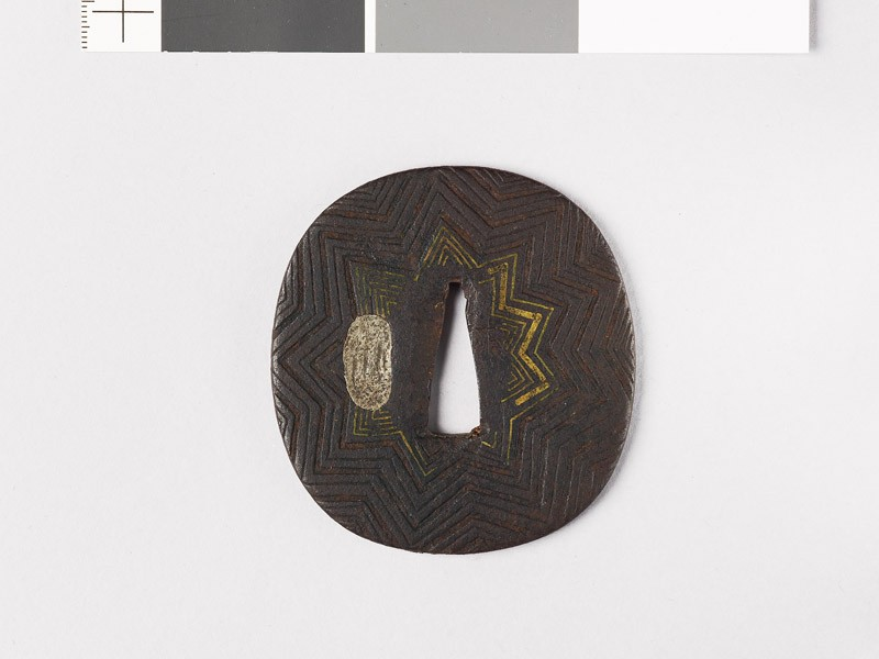 Tsuba with nine-pointed star