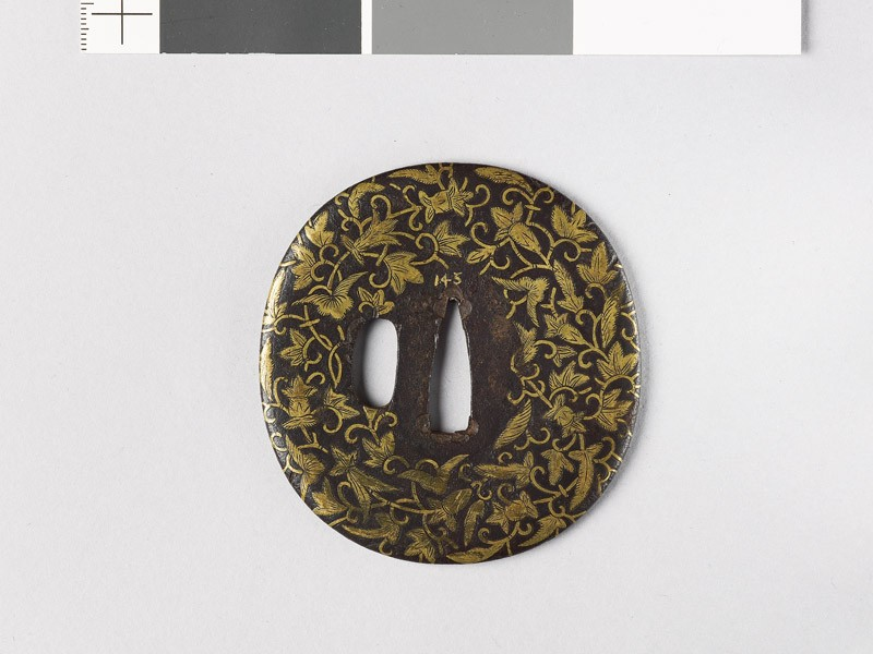 Lenticular tsuba with leaves and flowers (EAX.10151, front           )