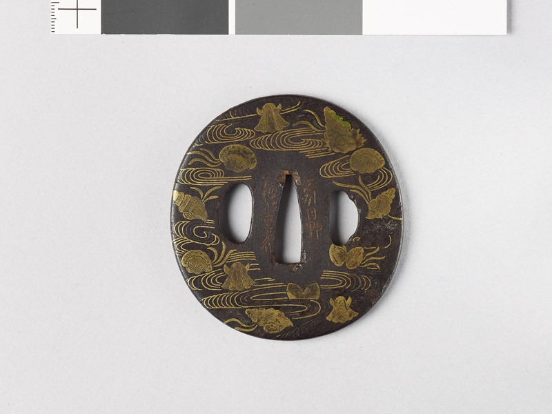 Tsuba with seashells amid water (front           )