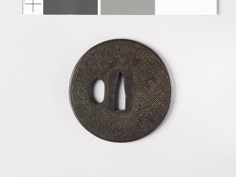 Round tsuba with swastikas (front           )