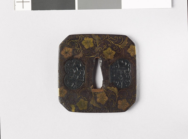 Square tsuba with karakusa, or scrolling floral pattern