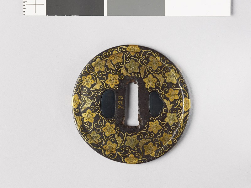 Round tsuba with karakusa, or scrolling floral pattern