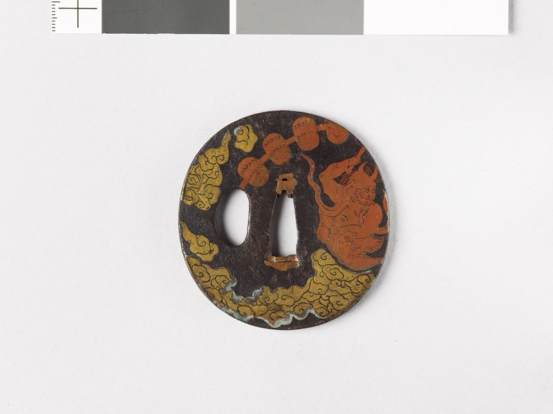 Round tsuba depicting Raiden, the god of thunder (EAX.10164, front           )
