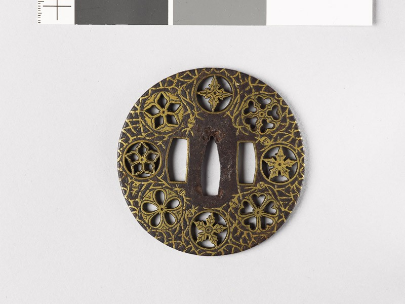 Round tsuba with flowers and water-weeds