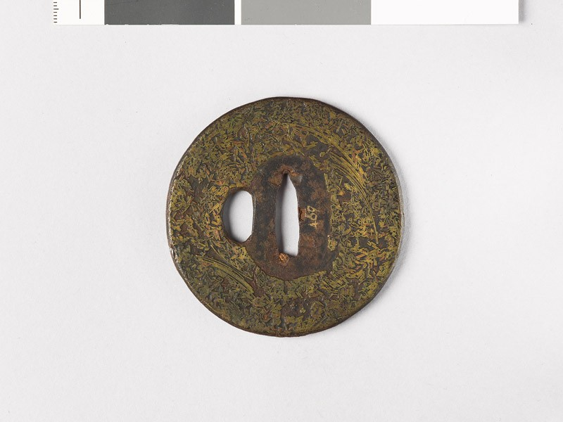 Tsuba incrusted with brass wire (front           )