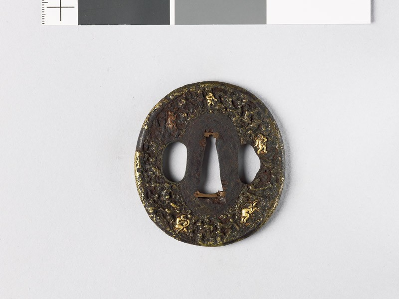 Tsuba with 'stick-lac' decoration and monkeys amid rocks (EAX.10177, front           )