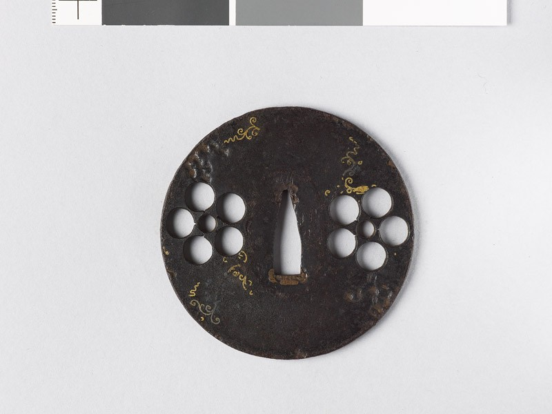 Round tsuba with heraldic mon and scrolls (front           )