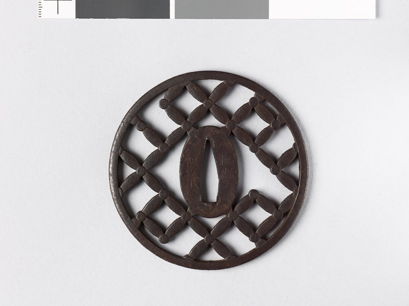 Round tsuba with shippō diaper of interlaced circles