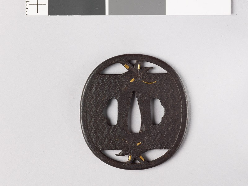 Tsuba with two maple leaves