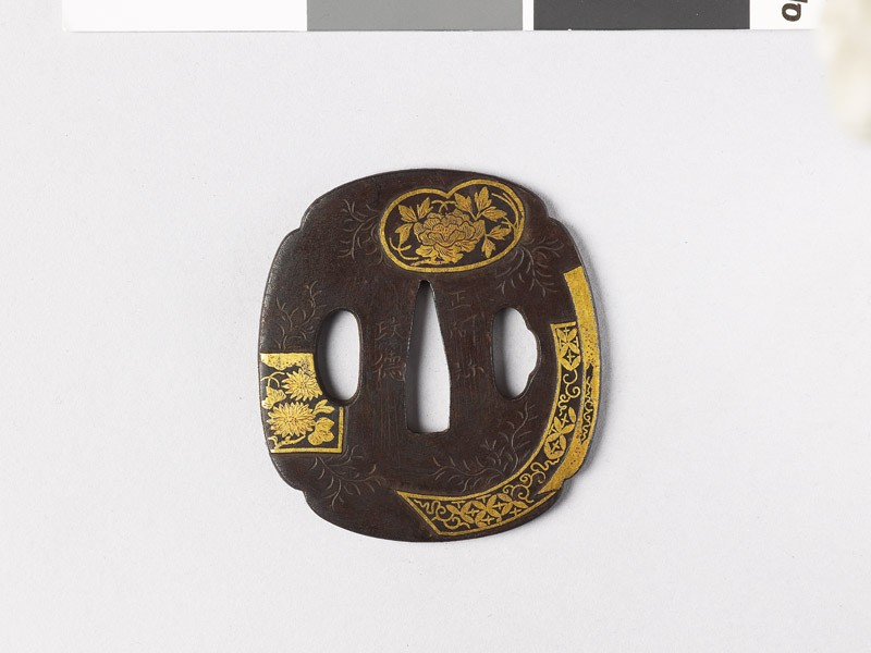 Tsuba with fan mounts and flowers (front             )