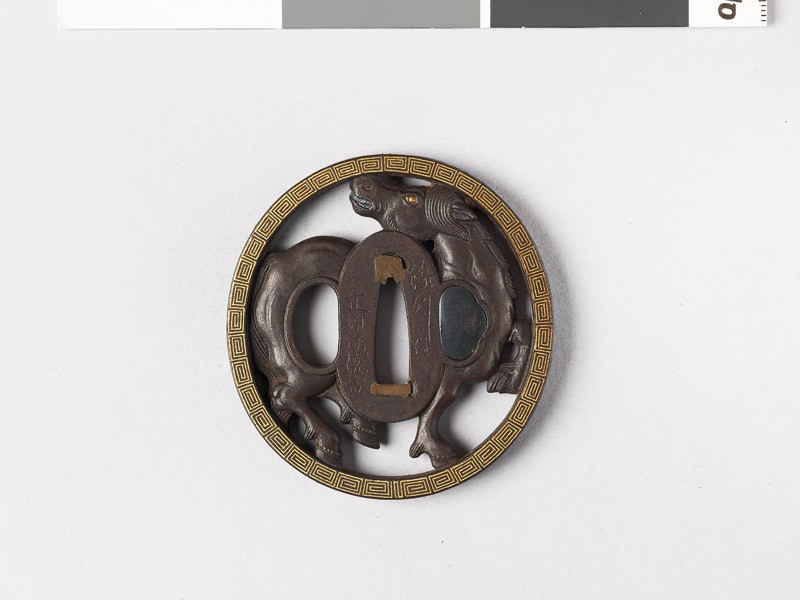 Tsuba with horse and key pattern