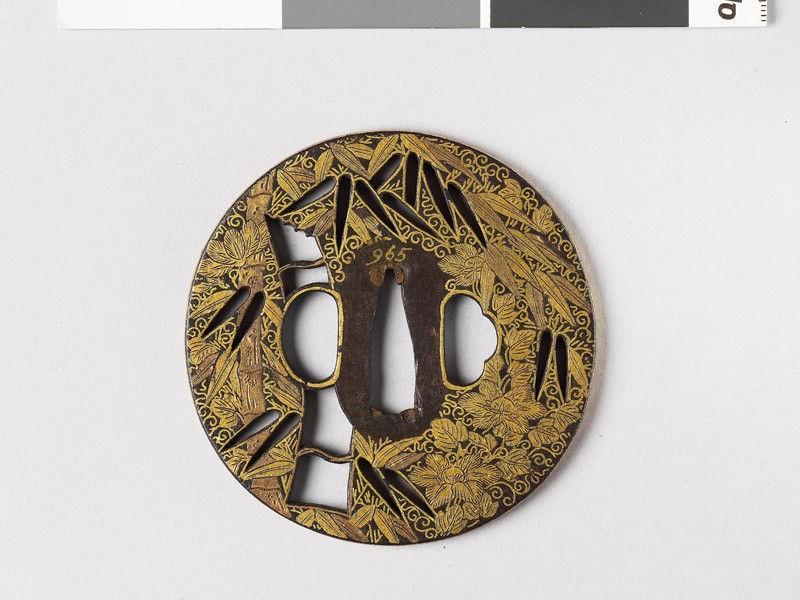 Round tsuba with bamboo and clematis (front           )