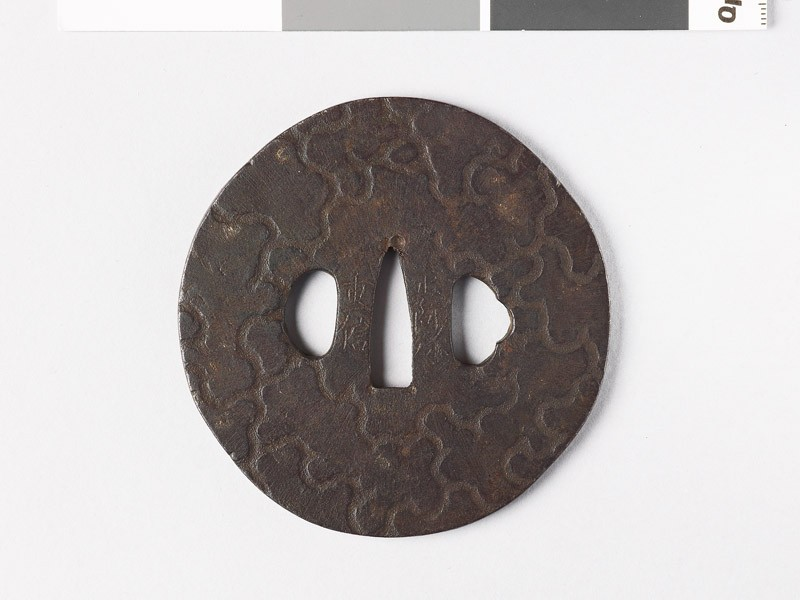 Tsuba with design of insect-eaten wood (front           )
