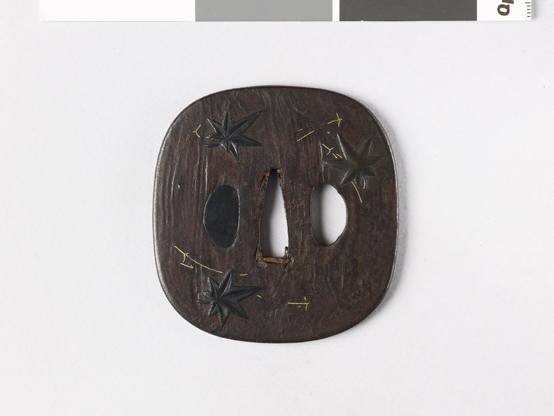 Tsuba with maple and pine leaves (front           )