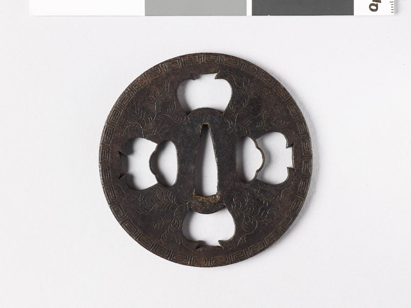 Tsuba with key pattern and seaweed-like sprays (front           )