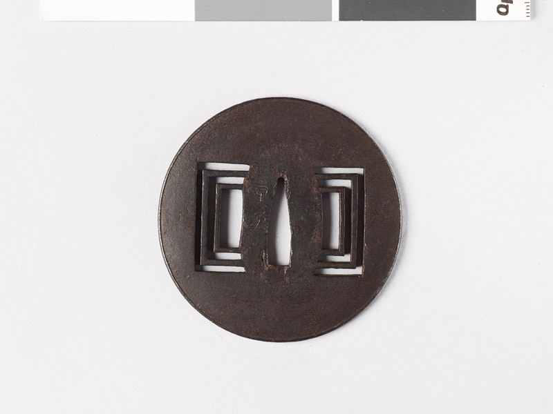 Tsuba with raised edge and oblong piercings