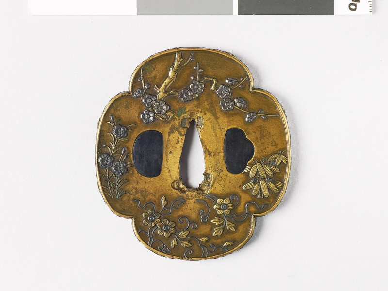 Mokkō-shaped tsuba with flowers and plants