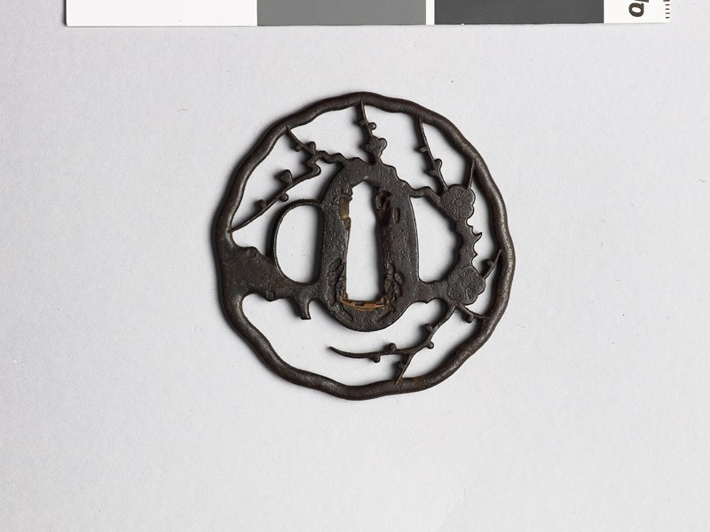 Tsuba with blossoming plum branches
