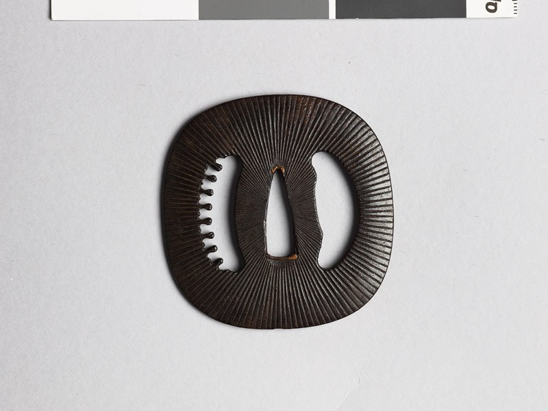 Lenticular tsuba with Amida-yasurime, or radial striations