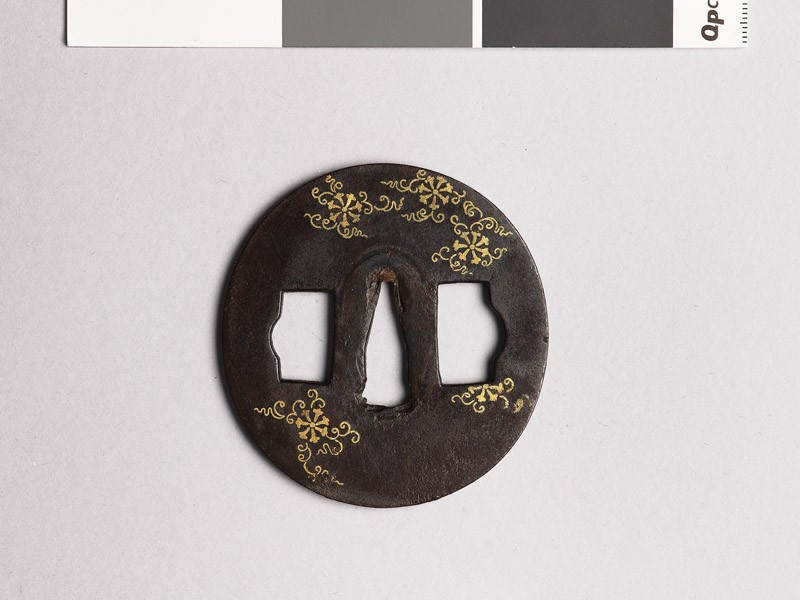 Tsuba with flowers and scrolls