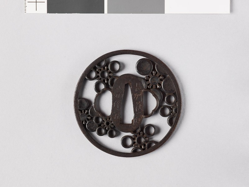 Round tsuba with mon crests of the Mayeda family