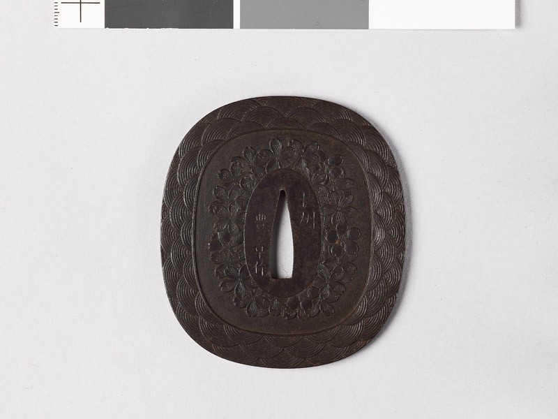Tsuba with waves and cherry blossoms