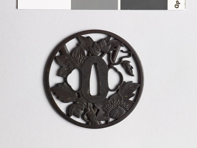 Round tsuba with clematis vine and dewdrops (front           )