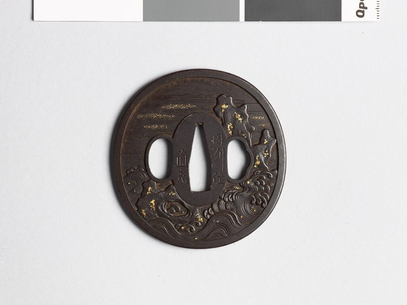 Tsuba with rocks and waves