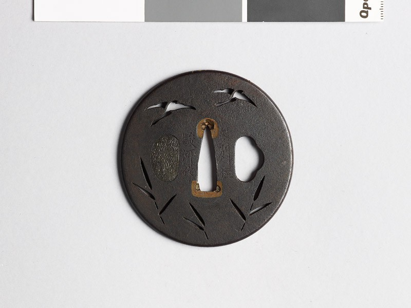 Tsuba with geese flying above reeds