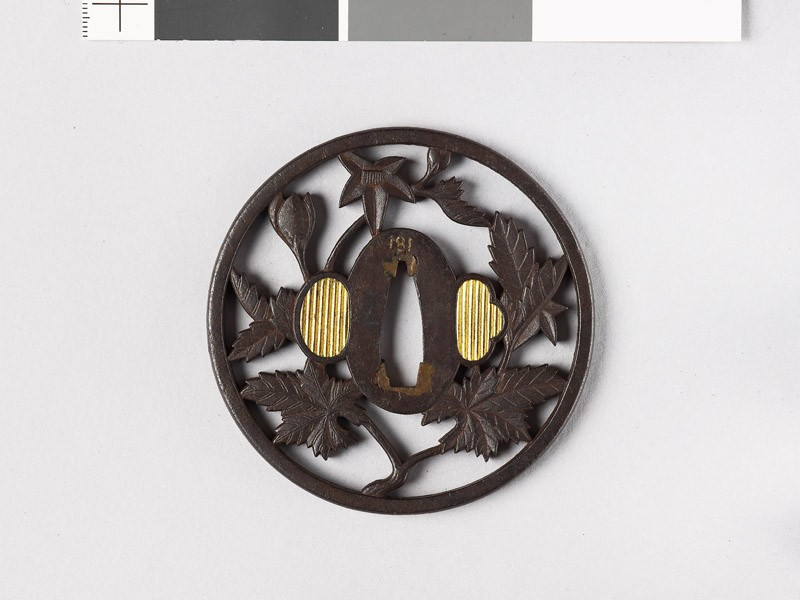 Round tsuba with flowering branch (front           )