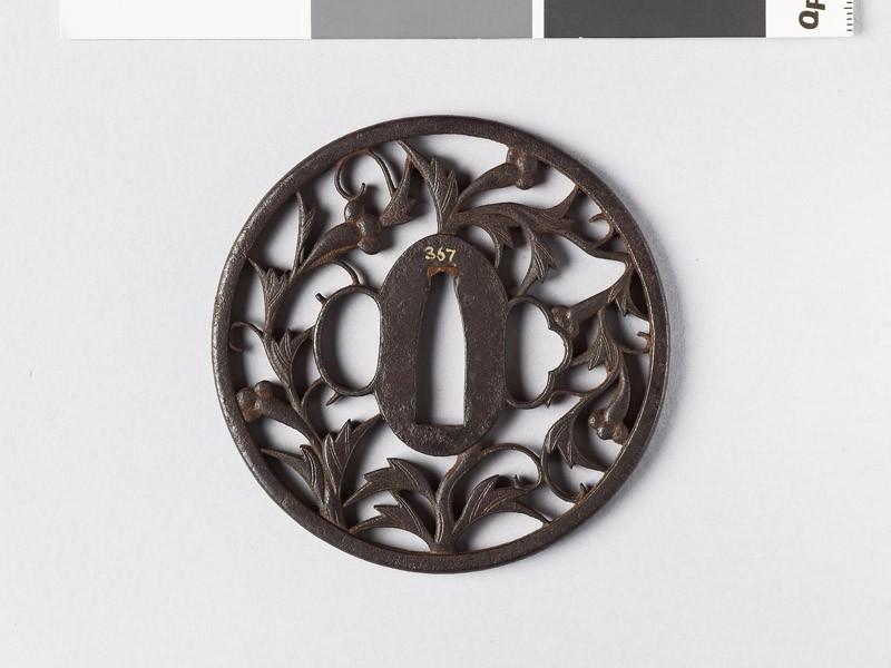 Round tsuba with karakusa, or scrolling plant pattern