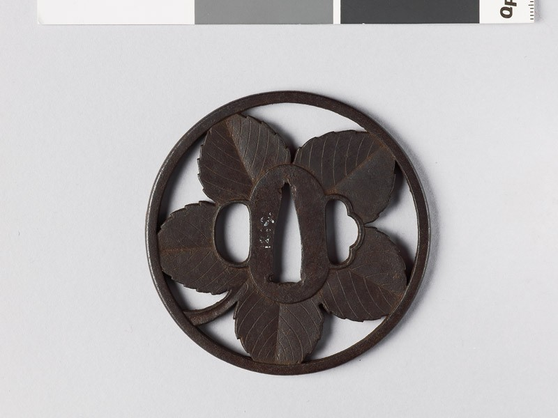 Round tsuba with paper mulberry leaf