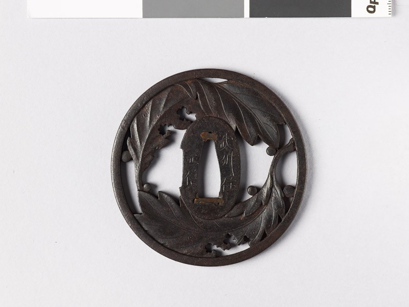Round tsuba with oak leaves and dew drops